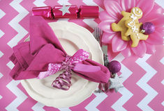 Christmas children family party table place settings in pink and white theme Stock Photo