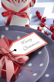 Christmas children family party table place settings in purple, red and white Royalty Free Stock Photography