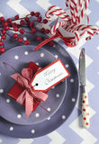 Christmas children family party table place settings in purple, red and white Royalty Free Stock Photos