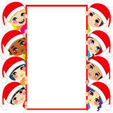 Christmas Children Friends. Group of multi-ethnic kids wearing Santa Claus hats holding a blank white placard with copy space for text Royalty Free Stock Images