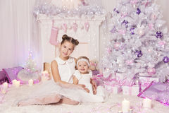 Christmas Children, Kid Baby Girls, Decorated Pink Room. Christmas Children, Kid and Baby Girls with Present Gift, Decorated Pink Room Xmas Tree Royalty Free Stock Photos