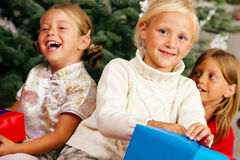 Christmas - Children with presents royalty free stock photography