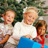 Christmas - Children with presents. Family Christmas - three children having received gifts showing them around Stock Image