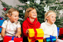 Christmas - Children with presents. Family Christmas - three children having received gifts showing them around Stock Photo