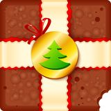 Christmas chocolate box with badge and ribbon Royalty Free Stock Photo