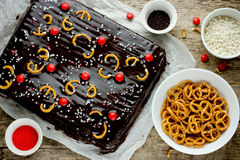 Christmas chocolate cake decorated with candy pretzels deer. Top view Stock Photo