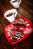 Christmas chocolate cake dessert with pomegranate and coffee Stock Image