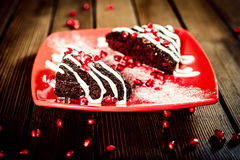 Christmas chocolate cake dessert with pomegranate on wooden tabl Royalty Free Stock Images