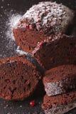 Christmas chocolate cake stuffed with cranberries macro. vertica Stock Photos