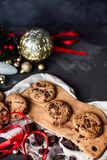 Christmas chocolate chip cookies on dark table with christmas decoration and red ribbon royalty free stock photos