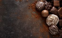 Christmas chocolate cookies and pralines on a dark stone slab wi. Th large copy space, high angle view from above royalty free stock image