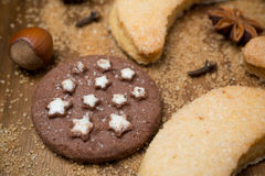 Christmas chocolate cookies, spices and nuts on a wood Stock Photo