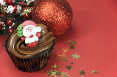 Christmas chocolate cupcake with Santa face and copy space Stock Photography
