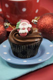 Christmas chocolate cupcake with Santa face - vertical close up Royalty Free Stock Images