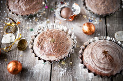 Christmas chocolate cupcake on wooden boards.Winter holidays con Royalty Free Stock Image