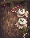 Christmas chocolate cupcakes with cream cheese frosting. Royalty Free Stock Photography