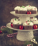 Christmas chocolate cupcakes with cream cheese frosting. Stock Images