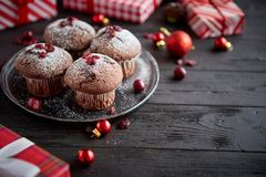 Christmas chocolate delicious muffins served on black ceramic plate stock photography