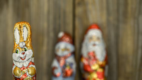 Christmas chocolate figures in a wrapper. On wooden background Stock Photography