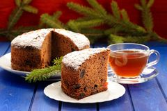 Christmas chocolate fruit cake with black tea and fur brunch on Royalty Free Stock Images