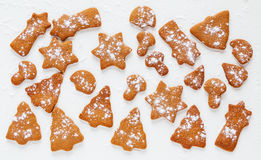 Christmas chocolate and ginger brown cookies in shape of fir-tree, star, moon and mushrooms. Stock Images