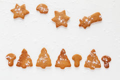 Christmas chocolate and ginger brown cookies in shape of fir-tree, star, moon and mushrooms. Royalty Free Stock Photo