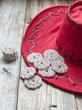 Christmas chocolate on a red hat. Chocolate biscuits on a red hat and wood background Royalty Free Stock Photos