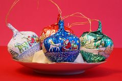Christmas chocolates. Decorative Christmas chocolate balls or balls with red background Royalty Free Stock Images