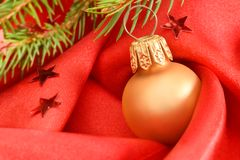 Christmas. Background with gold ball on red Stock Images
