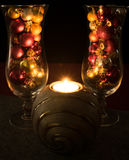 Christmas, Christmas balls filled champagne glasses with tea lig Stock Images
