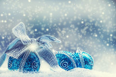 Christmas. Christmas blue balls and silver ribbon snow and space abstract background. Stock Photo