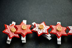 Christmas. Decoration  red stars  on black background .With copy-space Royalty Free Stock Image