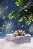 Christmas. Christmas gift box in abstract snowy scene. Christmas time Royalty Free Stock Images