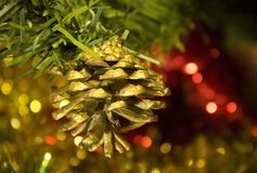 Christmas Christmas golden toy cone on a branch of a New Year tree close up Royalty Free Stock Photography