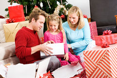 Christmas: Christmas Morning Family Present Time Stock Photography