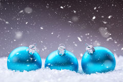 Christmas. Christmas Time. Blue Christmas balls in the snow and snowy abstract scenes.  Royalty Free Stock Image