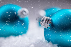 Christmas. Christmas Time. Blue Christmas balls in the snow and snowy abstract scenes.  Stock Images