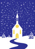 Christmas church of snowy landscape. Romantic Christmas church of snowy landscape, vertical Royalty Free Stock Photography