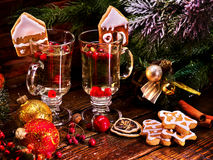 Christmas cider cocktail from mulled wine decoration house biscuit. Still life cookies plate and berry. Restaurant table decoration by christmas ball. Warming Royalty Free Stock Image