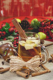 Christmas cider. Glass of Mulled Cider for Christmas with  spices over rustic wood background Royalty Free Stock Images