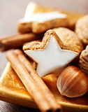 Christmas cinnamon cookies and nuts Stock Photos