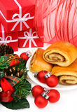 Christmas cinnamon rolls. And red ornaments. Traditional christmas morning breakfast Royalty Free Stock Photography