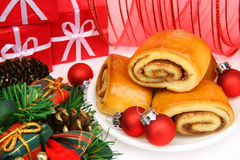 Christmas cinnamon rolls. And red ornaments. Traditional christmas morning breakfast Stock Photo