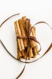 Christmas cinnamon. Cinnamon tied with brown ribbon Stock Image