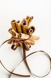 Christmas cinnamon. Cinnamon tied with brown ribbon Stock Photo