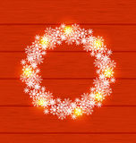 Christmas circle frame made in snowflakes on red wooden backgrou Stock Photo