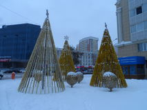 Christmas in the city. Astana, Christmas tree on the square; some decorations for the Christmas celebration; square near the entertainment center Khan Shatyr Stock Photography
