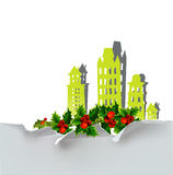 Christmas city background with holly made of paper stickers Stock Photo