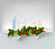 Christmas city background with holly made of paper stickers Stock Image