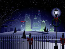 Christmas city landscape. Urban landscape with park and city at Christmas time Royalty Free Stock Photo